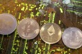 Representations of the Ripple, bitcoin, Etherum and Litecoin virtual currencies. While developed economies are slower to act, smaller and emerging economies are fashioning themselves as crypto-friendly hubs. Photo: Reuters