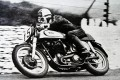 Reg Armstrong, on a Norton, winner of the Trophy race of 1952, (Senior) is seen here tackling a corner on the course. Photo: Alamy Stock Photo