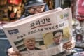 A man reads a copy of the Munhwa Ilbo newspaper featuring news of US President Donald Trump and North Korean leader KimJong-un on the front page in Seoul. Photo: Bloomberg