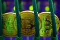 PwC said it will leverage AI in it blockchain analytics to track the movement of digital tokens. Photo: Bloomberg