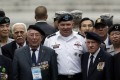 James Thurman, a retired Army general (centre), is one of two new candidates for the post of US ambassador to Seoul. Pictured: Thurman with Korean war veterans at the 60th anniversary of the Korean war armistice agreement. Photo: AP