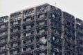 The charred remains of cladding are pictured on the outer walls of the burnt out shell of the Grenfell Tower block in north Kensington, west London on June 22, 2017. Photo: AFP
