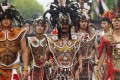Borneo's Dayak people wearing traditional dress. The Last Wild Men of Borneo explains that the Dayak often bullied the shy and placid Penan, another of the island's indigenous groups. Photo: Shutterstock