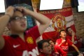 Members of the Manchester United Shanghai fan club react as they watch a telecast of the team on TV. Photo: Reuters