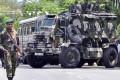 Sri Lankan police commandos patrol the streets of Pallekele, a suburb of Kandy. File photo: AFP