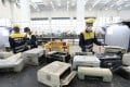 Staff working at the Hong Kong government's Waste Electrical and Electronic Equipment facility in Tuen Mun. Photo: Edward Wong