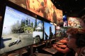 Gamers play Ubisoft's Far Cry 5 game at the Electronic Entertainment Expo in Los Angeles, California, in June last year. The French video games publisher is best known for its Assassin's Creed and South Park games. Photo: EPA