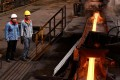 A file picture of workers at a steel plant in China's Shandong province. Photo: Agence France-Presse
