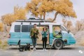 The couple pictured outside their converted motor home. Photo: Weibo