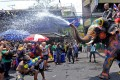 Foreign tourists spray an elephant with water guns as it spouts water during the Songkran festival to mark the Thai new year along the Khao San Road in Bangkok. Photo: AFP