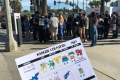 A large group prepares to take on the legendary Pokémon Kyogre on the Santa Monica Pier. The flyer, handed out by a Pokémon Go enthusiast group, lists its weaknesses. Photo: Matt Weinberger/Business Insider