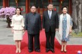 North Korea's first lady Ri Sol-ju (left) wore a two-piece ivory-coloured dress for a lunch with Xi Jinping and China's first lady Peng Liyuan. Photo: Reuters