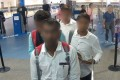 The group of fake reporters arrive at Brisbane Airport on Wednesday holding Temporary Activity Visas, claiming to be accredited media representatives, in this photo provided by the Australian Border Force. Photo: ABF
