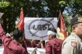 A group of Muslim protesters march with banners against the lesbian, gay, bisexual and transgender community in Banda Aceh in 2017. Photo: AFP