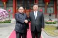 North Korean leader Kim Jong-un and China President Xi Jinping shaking hands during Kim's visit to Beijing. Photo: AFP/KCNA via KNS