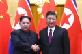 Kim Jong-un (left) pictured with President Xi Jinping during their meeting in Beijing. Photo: Xinhua