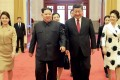North Korean leader Kim Jong-un with Chinese President Xi Jinping and their wives in Beijing. Photo: AFP
