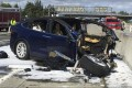 Emergency personnel work a the scene where a Tesla electric SUV crashed into a barrier. Photo: AP