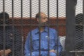 Saif al-Islam on trial in 2013. File photo: AFP