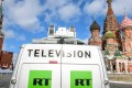 A Russia Today (RT) television broadcast van is seen parked in front of St Basil's Cathedral and the Kremlin next to Red Square in Moscow on March 16, 2018. The Russian-backed TV channel RT disappeared from broadcasts around Washington. The network vanished from cable channels on April 1, 2018, when the station that ran RT permanently closed. Photo: AFP