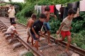 Children play on unused railway line in Phnom Penh, Cambodia. A missing 48km stretch of railway that connects the capital Phnom Penh to the Thai border has been rebuilt, 45 years after it was destroyed in the 1970s during the Cambodian civil war. Photo: AFP