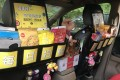 A selection of the goods on sale in the back of a Shenzhen cab. Photo: xfz.cn