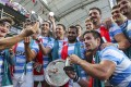 Argentina players celebrate their Plate win against the USA in a fierce finale. Photo: K. Y. Cheng