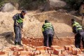 Workers knocking down a tomb in Tongcheng county. Photo: Aihami.com