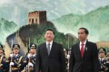 Chinese President Xi Jinping (left) and Indonesian President Joko Widodo view a guard of honour inside the Great Hall of the People in Beijing on March 26, 2015. Photo: AFP
