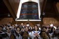 The choir sings at a Holy Saturday Mass at the Cathedral of the Immaculate Conception, a government-sanctioned Catholic Church in Beijing, on March 31. Photo: AP