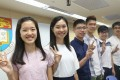 Top achievers in the 2017 Hong Kong DSE are all smiles in front of the crest of the University of Hong Kong, their new alma mater, as they meet the media at the HKU campus, on August 7 last year. Photo: David Wong