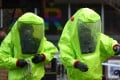 Emergency crews in biohazard suits attend the scene where the toxic nerve agent was used in Salisbury, southern England. Photo: AFP