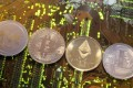 Representations of (left to right) the Ripple, Bitcoin, Etherum and Litecoin virtual currencies are seen on a PC motherboard. Photo: Reuters