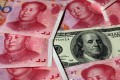 A weaker yuan is likely to trigger a massive exodus of funds from China. Photo: Reuters