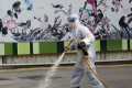 A worker cleansing the streets near the bird garden and market in Mong Kok. Photo: Felix Wong