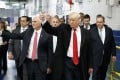 Then-President-elect Donald Trump and then-Vice-President-elect Mike Pence visit a Carrier factory in Indianapolis in December 2016. Trump has taken a tough position on trade, claiming that the policies of his predecessors have failed the American working class. Photo: AP