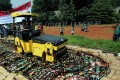 Indonesian police destroy thousands of bottles of illegal home-made alcohol. Photo: AFP