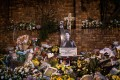 Flowers and tributes at a memorial outside the home of Winnie Madikizela-Mandela before her funeral ceremony on April 14. Photo: AFP