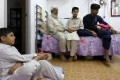 From left: Haseeb, Fazal, Ayaz, Ibrar and Sana have been waiting for public housing since 2012. They have been living in a cubicle home since 2010 because of the long wait and difficulties finding a better place. Photo: Sam Tsang