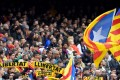 Barcelona fans hold up scarves demanding freedom during the match against Valencia CF at the Camp Nou. Photo: AFP
