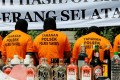 Suspects arrested for producing and selling illegal home-made alcohol are put on parade by Indonesian police during a public display in South Tangerang, outside Jakarta. Photo: AFP