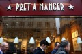 People walk past a Pret A Manger cafe in London. Photo: Reuters