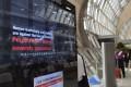 A television screen showing a message warning against human trafficking at Bangkok's main Suvarnabhumi Airport. Photo: Thomson Reuters Foundation