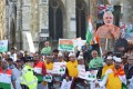 Demonstrators holds placards and pictures of India's Prime Minister Narendra Modi in Parliament Square on Wednesday. Photo: Reuters