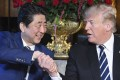 US President Donald Trump and Japanese Prime Minister Shinzo Abe shake hands during a meeting in Palm Beach, Florida. Photo: Kyodo