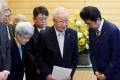 Japanese Prime Minister Shinzo Abe, right, meets Shigeo Iizuka, the leader of a group of families whose relatives were abducted by North Korea. Photo: Reuters