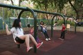 Swings offer some fun at a playground in Victoria Park in Causeway Bay. Photo: Edmond So