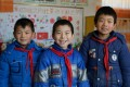 Du Yongsheng, Chang Wenxuan and Shi Zhengang, all aged 10, are the only remaining pupils at the primary school inLumacha village, in China's northwestern Gansu province. Photo: Tom Wang