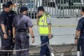 Malaysian Police collect evidence at the crime scene where a Palestinian scientist Fadi Mohammad al-Batsh was reportedly assassinated in a drive-by motorcycle shooting in Kuala Lumpur. Photo: EPA