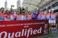 China's women's sevens team celebrate success at the Cathay Pacific / HSBC Hong Kong Sevens at Hong Kong Stadium. Photo: Edward Wong